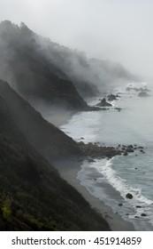 Fog and closing steep cliffs at Big Sur, California