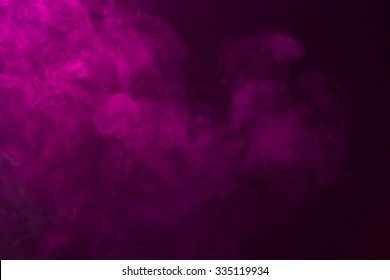 Fog colored with bright pink gel on dark background. 1