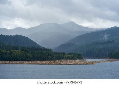 Fog cover forest mountains near Swift Reservoir in rainy weather in autumn season. Washington State, USA Pacific Northwest.