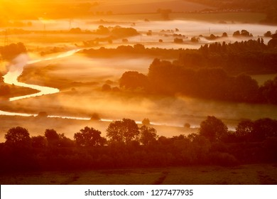 Fog covering part of South Downs National Park and Ouse River at dawn