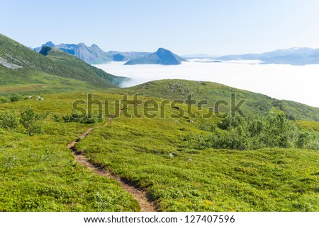 Fog is covering Skaland and Bergsfjorden, Troms, Senja, Norway