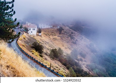 Fog covering the slopes of Mt Hamilton, the highest peak in the Diablo Mountain Range and the location of Lick Observatory complex, San Jose, South San Francisco Bay Area, California