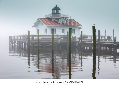 Fog covers the historic lighthouse and tourist attraction on Shallowbag Bay in downtown Manteo on the Outer Banks of North Carolina.