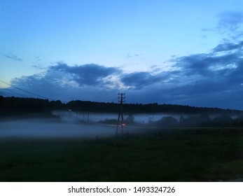 Fog in the evening on the field with a car.