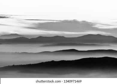 Fog filling a valley in Umbria (Italy), with layers of mountains and hills