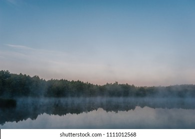 Fog, grass, trees against the backdrop of lakes and nature. Fishing background. Carp fishing. Misty morning. nature. Wild areas. the river.