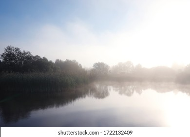Fog in the lake. Morning nature water and white fog.