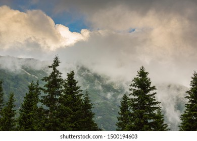 Fog and mist clouds in the Transylvanian Alps, in the evening, on a summer day