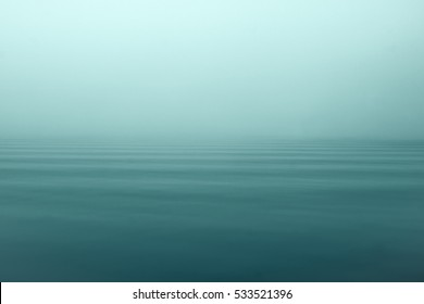 Fog and mist on open sea creating a mystical and quiet scene.