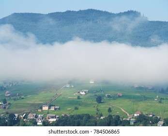 Fog and mist at the village in the carpatian mountains