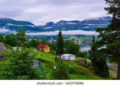 Fog in the mountains. Beautiful Innvikfjord and mountains landscape from Innvik village. Innvikfjorden er en delfjord av Nordfjord i Stryn kommune i Sogn og Fjordane. Norway.