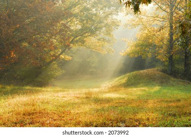Fog on a fall morning in rural Tennessee creating sun rays.