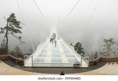The fog on Mirror Bridge across  in Zhangjiajie, China