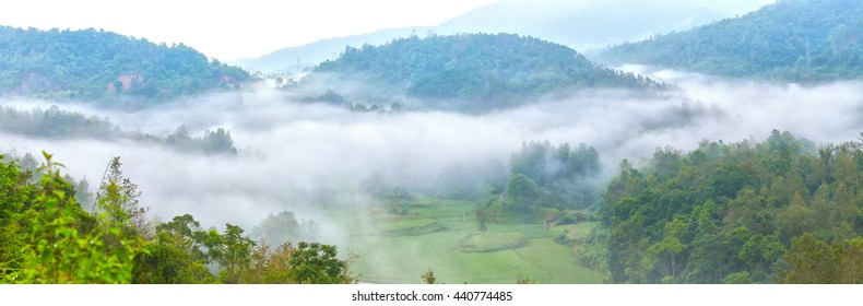 Fog on mountain in northwestern Vietnam with clouds covering  mountain permissive dim, beneath rice fields all created beauty idyllic, peaceful beautiful highland Vietnam