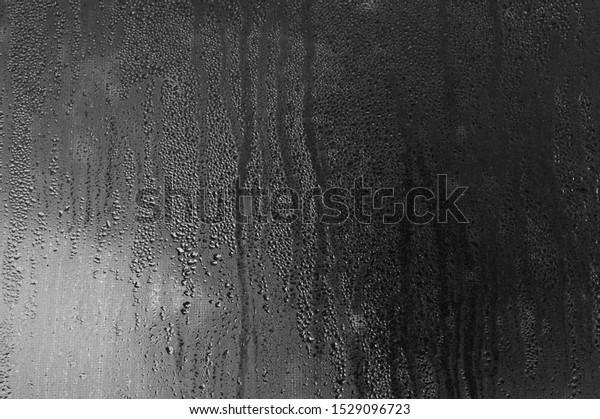 fog-on-window-glass-drops-600w-152909672