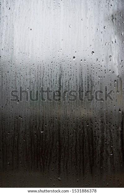 fog-on-window-glass-drops-600w-153188637