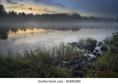 Fog over lake in Halsingland, Sweden, in the early morning
