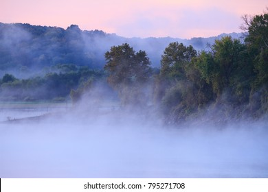 Fog over Truman Lake with pastel colors in the sky.  Truman lake is in the Lake of the Ozarks area of Missouri.