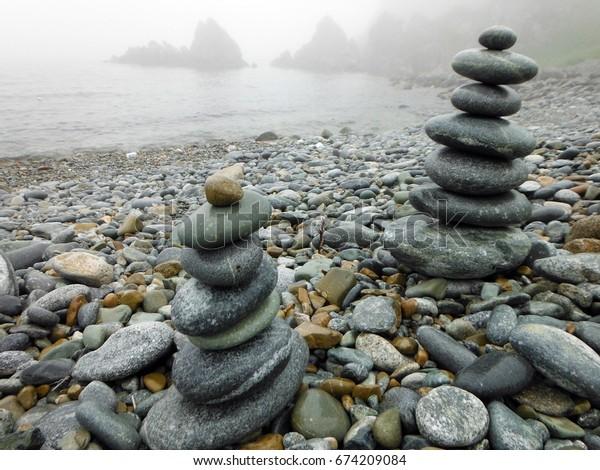 Fog, rain, sea, rocks, pyramid. Gamov Peninsula. Primorye. July 8, 2017.
