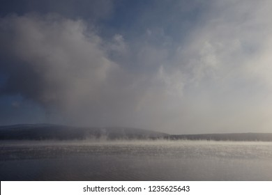 Fog rising on the river - the horizontal separation of two environments - air and water create a visual spectacle. Clouds form hot steam