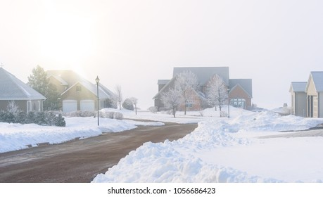 Fog rolling in on a North American residential neighborhood in winter.