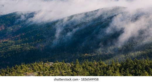 Fog rolling over Mount Monadnock in the morning on an autumn day in Jaffrey New Hampshrie