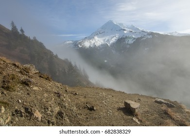 Fog rolling over the pass near snow capped Mt Hood