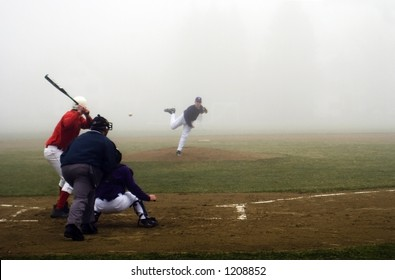 The fog rolls in on a high school baseball game in Maine.