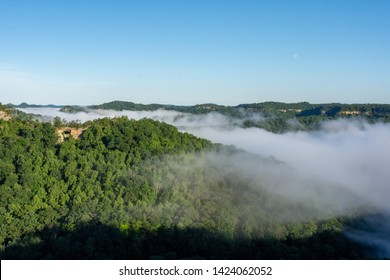 Fog rolls in through the Red River Gorge at Double Arch