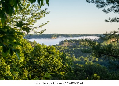 Fog is visible during the morning sunrise in Red River Gorge, Kentucky.