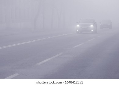 Fog weather and highway in city. Car Driving in Dense Fog. Dangerous Road Conditions