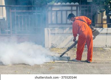 Fogging DDT spray kill mosquito for control Malaria, Encephalitis, Dengue and Zika in village at Bangkok Thailand.