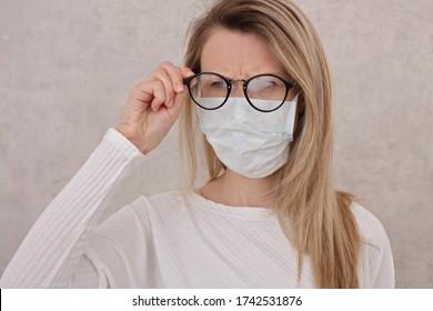 Fogging Glasses , Woman wearing Medical mask. Coronavirus prevention, Protection.