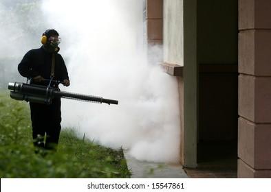 Fogging to prevent spread of dengue fever.