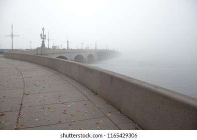 Foggy atmospheric city landscape of the road leading to the bridge disappearing in the mist, Saint Petersburg