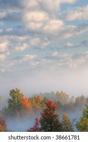 Foggy autumn landscape with beautiful clouds Kalamazoo River Valley, Michigan, USA