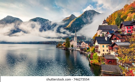 Foggy autumn scene of Hallstatt lake. Splendid morning view of Hallstatt village, in Austria's mountainous Salzkammergut region, Austria. Beauty of countryside concept background.