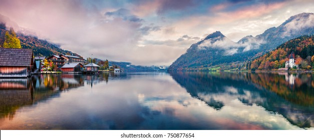 Foggy autumn sunrise on Grundlsee lake. Impressive morning panorama of Brauhof village, Styria stare of Austria, Europe. Colorful view of Alps. Traveling concept background.