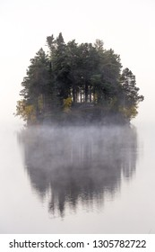 Foggy autumnal morning by the lake Jonsvatnet. Natural sunrise light. Trondheim area in Norway.