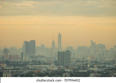 a foggy city during sunrise