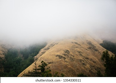 Foggy and Cloudy Mountains in California give a moody eery feeling while camping