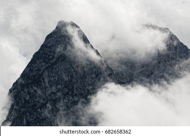 Foggy and cloudy mountains scenery in the Alps