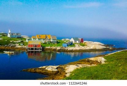 Foggy coastal Peggy's Cove fishing village in Nova Scotia