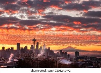 Foggy colorful sunrise over the Seattle skyline with Mount Rainier