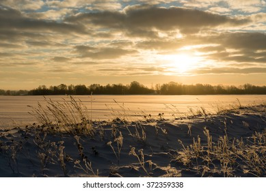 foggy country fields in winter on cold morning with snow