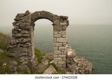 Foggy day spring in the medieval fortress with ancient arch at  Kaliakra headland, Black Sea Coast, Bulgaria