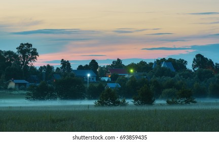 Foggy evening in countryside. Russia