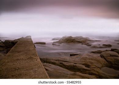 Foggy evening at elba island in winter