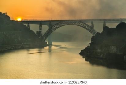 Foggy evening in Porto. A view of the Arrabida Bridge.