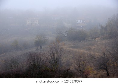 Foggy fuzzy view of the mountain village in the Balkans